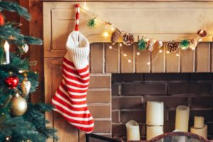 Striped sock for gifts on a fire-place