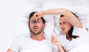 Woman Trying To Stop Snoring